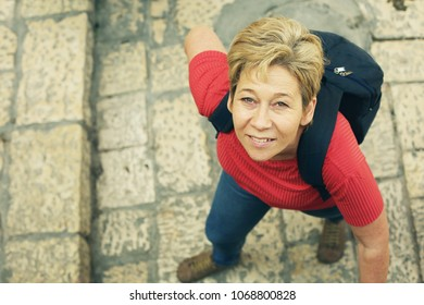 Portrait of beautiful smiling 45 years old woman enjoys traveling