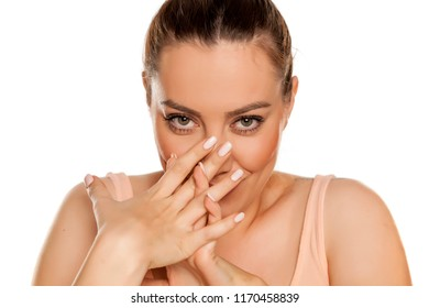 Portrait of beautiful smiling ashamed woman on white background