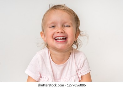 Portrait of beautiful smiling baby on isolated background