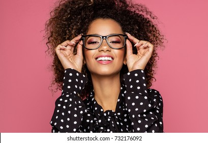 Portrait of the beautiful smiling black woman wear glasses