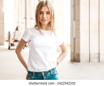 Portrait of beautiful smiling blond model dressed in summer hipster clothes. Trendy girl posing in the street background. Funny and positive woman having fun