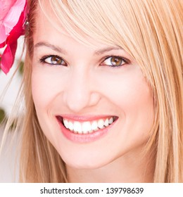 Portrait of a beautiful smiling blonde woman.