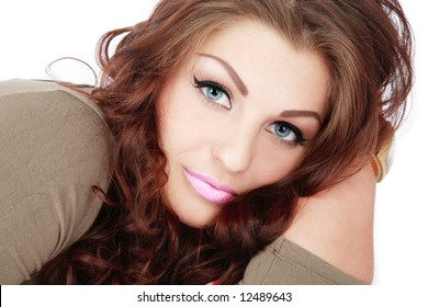Portrait of beautiful smiling blue-eyed girl with curling hair