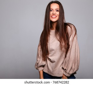 ab9d568d23e Portrait of beautiful smiling cute brunette woman model in casual beige  warm sweater clothes with no