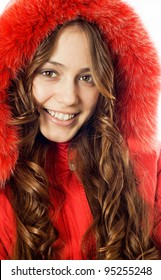 Portrait of a beautiful, smiling girl dress red fur coat