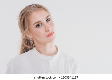 portrait of a beautiful smiling girl with long hair. Face of girl close up