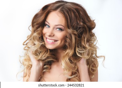 Portrait of beautiful smiling girl with luxuriant hair curling