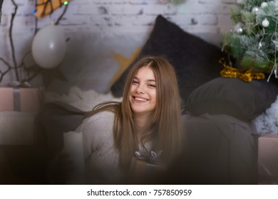Portrait of a beautiful and smiling girl, New Year's concert