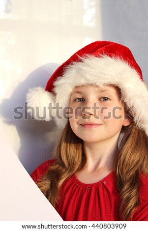 06cbcd09dcbc2 the portrait of beautiful smiling little girl wearing on red dress and Santa  Claus hat on white background - Image