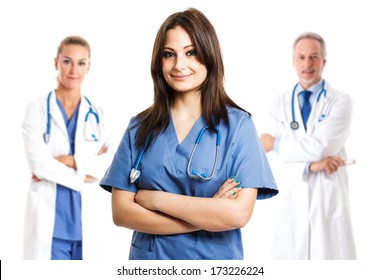 Portrait of a beautiful smiling nurse in front of her medical team