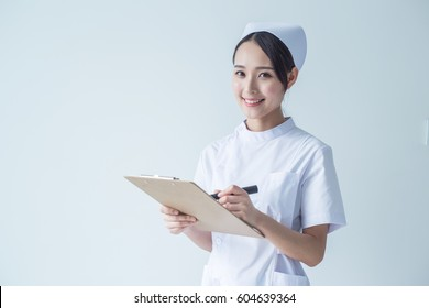 Portrait of a beautiful smiling nurse. Isolated on white