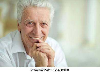 Portrait of beautiful smiling senior man posing