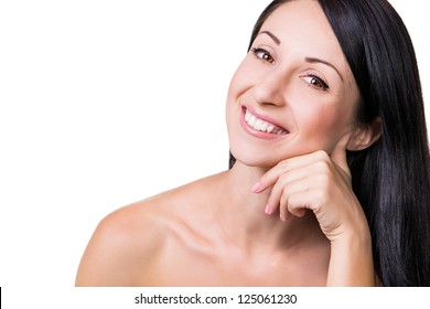 Portrait of a beautiful smiling woman with arm near her cheek