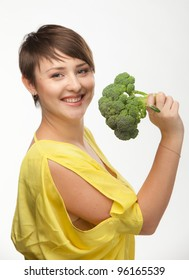 Portrait of a beautiful smiling woman with broccoli, isolated on white