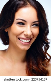 Portrait of a beautiful smiling woman with fresh skin looking away