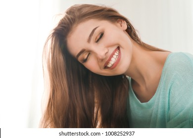 Portrait of beautiful smiling woman at home