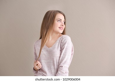 Portrait of beautiful smiling woman on light background