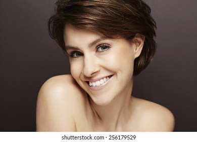 Portrait of beautiful smiling woman in studio