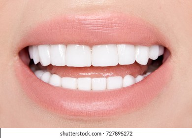 Portrait of a beautiful, smiling woman with  white teeth