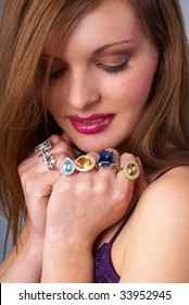 portrait of a beautiful smiling young brunettes with rings on his hands