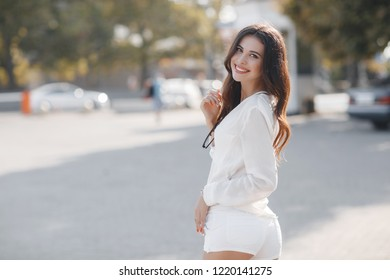 Portrait of a beautiful smiling young woman in summer outdoors