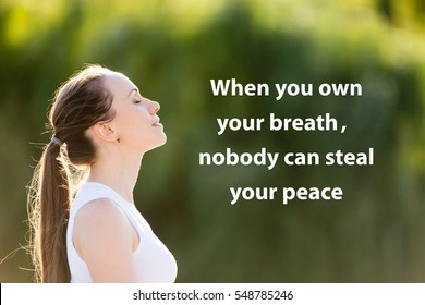 "Portrait of beautiful smiling young woman enjoying yoga, relaxing, feeling alive, breathing fresh air. Photo with motivational text ""When you own your breathe, nobody can steal your peace"""