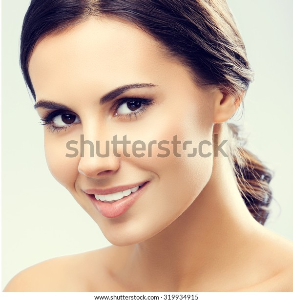 portrait of beautiful smiling young woman with naked shoulders