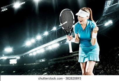 Portrait of beautiful sport woman tennis player with a racket
