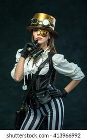 Portrait of a beautiful steampunk girl with binoculars. Victorian woman in alternative history.