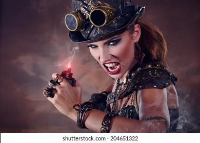 Portrait of a beautiful steampunk woman over smoke background.