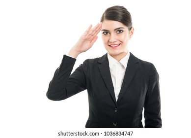 Portrait of beautiful stewardess making salute gesture with hand on head and smiling isolated on white background with copyspace advertising area