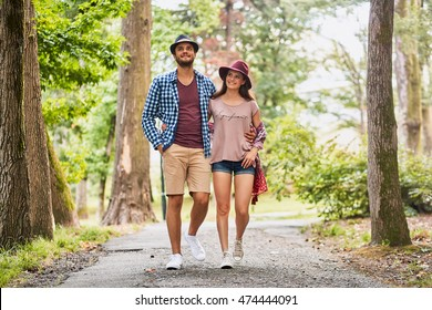 Portrait of a beautiful stylish couple walking on the street during summer vacation.
