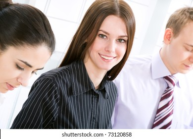 Portrait of the beautiful successful business woman busy working