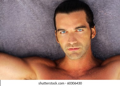 portrait of beautiful suntanned young man with blue eyes