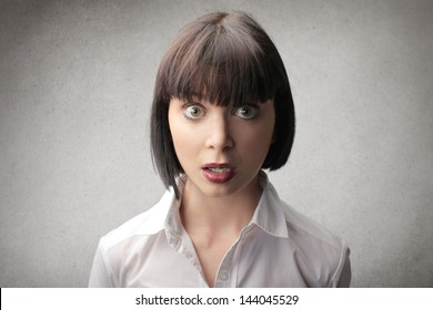 portrait of beautiful surprised woman