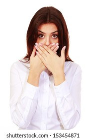 Portrait of a beautiful surprised woman with hands over her mouth isolated on white