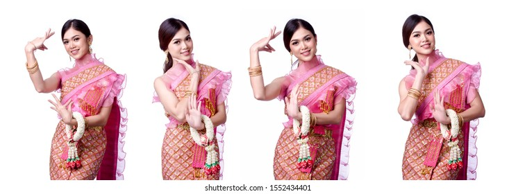 Portrait of a beautiful thai woman wearing a thai dress on white background