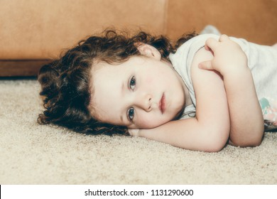 Portrait of Beautiful Three Year Old Looking Sad & Solemn
