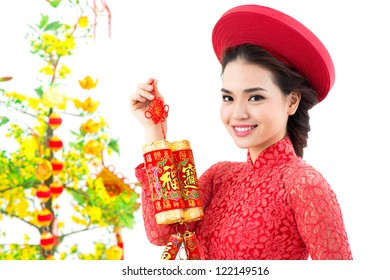 Portrait of a beautiful Vietnamese girl with firecrackers