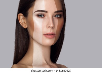 Portrait of beautiful white girl with stripes of different colour Foundation. Sample selection color of makeup. Beauty woman portrait close-up on a gray background. Long straight fair hair
