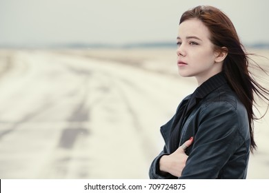 portrait of a beautiful winter girl outdoors