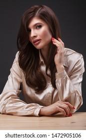 Portrait of beautiful woman against dark background