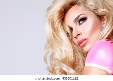 Portrait of the beautiful woman with amazing eyes of sensual makeup and perfect face, full lips and long eyelashes