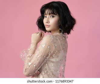 Portrait beautiful woman asian with clean skin, natural make-up,on  pink background