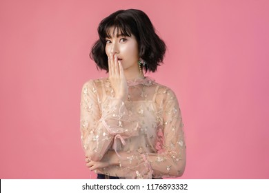 Portrait beautiful woman asian ,She used her hands to cover mouth