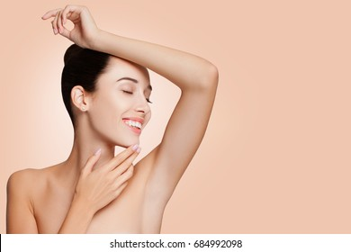 Portrait Beautiful Woman. Attractive Girl Posing at Studio  with copy space. Close-up Beauty Portrait Model  Woman smooth Armpits