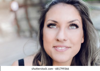 portrait of beautiful woman with bad and wrong work eyelash extension, pretty woman face with green eyes