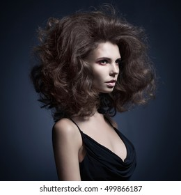 Portrait of beautiful woman with big hairs. Woman with art makeup. beautiful look of woman with professional hairstyle.
