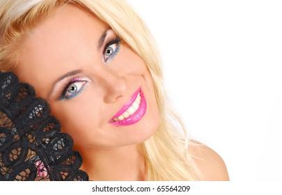 Portrait of a beautiful woman with black fan