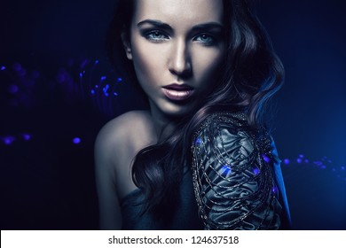 portrait of beautiful woman in blue light